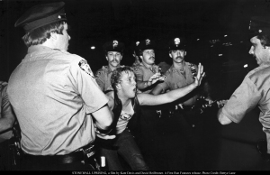 A patron of the Stonewall Inn confronts New York police, as seen in STONEWALL UPRISING, a film by Kate Davis and David Heilbroner. A First Run Features release. Photo Credit: Bettye Lane
